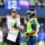 Pete Carroll and Russell Wilson throw Brian...