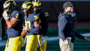 As coaching carousel spins, talk of Jim Harbaugh...